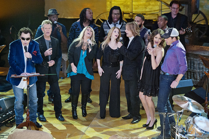 """Recording artists Ronnie Milsap, front left, Randy Travis, Natalie Grant, The Roys, Ashton Shepherd and Rodney Atkins join members of Committed, second row, to perform music from the """"Little House on the Prairie"""" books at Loveless Barn during filming of the PBS special """"Pa's Fiddle: American Music."""" (MTSU photo by Andy Heidt)"""