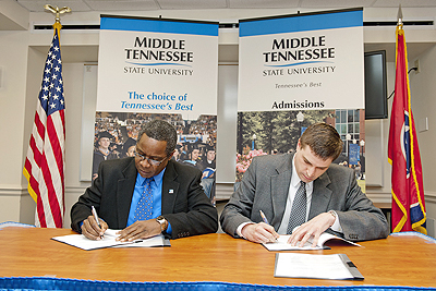 "MTSU President Sidney McPhee, left, and Travis Kraft, acting director of the Veterans' Affairs Nashville Regional Office, sign an agreement between MTSU and the U.S. Department of Veterans Affairs naming MTSU a ""VetSuccess"" University on March 13. (MTSU photo by Andy Heidt)"