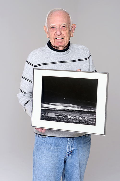 """MTSU Professor Emeritus Harold L. Baldwin displays one of the masterpieces in the renowned university gallery collection that bears his name: the Ansel Adams print of """"Moonrise, Hernandez, New Mexico."""" Baldwin, 93, founder of MTSU's photography program and a former president of the Faculty Senate, died March 19. (MTSU file photo by J. Intintoli)"""