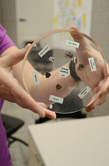 Dr. Irina Perevalova provides a close-up view of the lunar samples on display starting at 5 p.m. today on the MTSU campus. Lunar Sample #039 includes basalt; orange, highlands and mare soil; anorithosite and breccia.