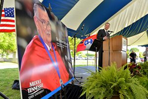 Jeff Whorley glances at a photo of his late uncle, Nobel laureate and MTSU alumnus James M. Buchanan during a special May 2013 celebration of Buchanan's life. (MTSU file photo by J. Intintoli)