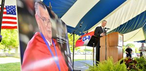 Jeff Whorley glances at a photo of his late uncle, Nobel laureate and MTSU alumnus James M. Buchanan, during a May 9, 2013, special celebration of Buchanan's life outside the Paul W. Martin Sr. Honors Building. Whorley announced the Buchanan estate's $2.5 million gift to the university. (MTSU file photo by J. Intintoli)