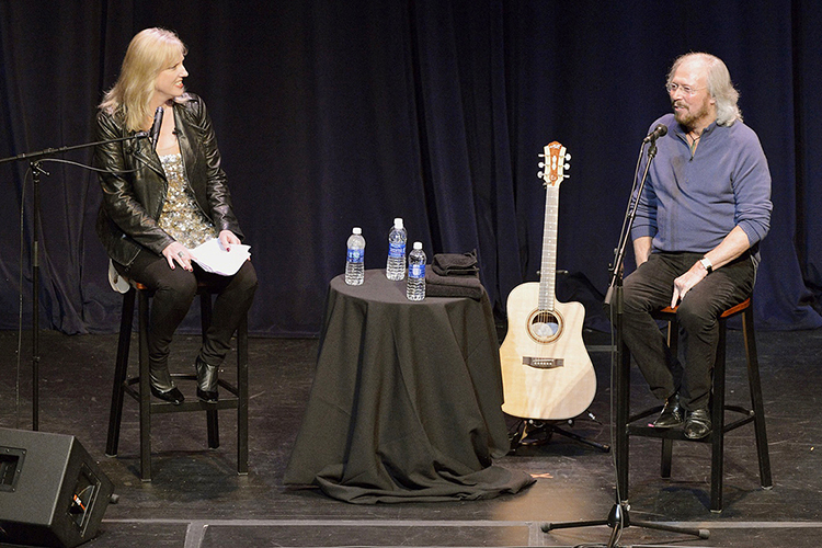 Music icon Barry Gibb, left, is caught off-guard by a question from Beverly Keel, chair of MTSU's Department of Recording Industry, during a special performance-lecture inside the university's Tucker Theatre Monday, Oct. 28. (MTSU photos by Andy Heidt)