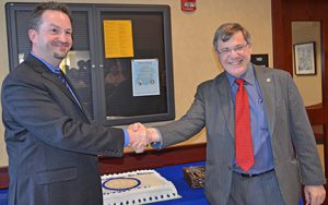 MTSU Honors College Associate Dean Philip Phillips accepts congratulations from Dean John Vile after Vile announced to the 2014 spring Honors Lecture Series Class that Philips would take the job permanently. (Photo by MTSU News and Public Affairs)
