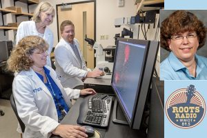 Dr. Mary Farone, seated in the foreground, Dr. Sharon Berk and MTSU doctoral candidate Brock Arivett view a graphic image, in this July 2016 file photo, of the amoebae that are part of their nearly 20-year study with Tennessee Tech researchers finding bacteria in a hot tub and cooling towers in Cookeville, Tennessee. The two bacteria species, which were named for Berk, are capable of infecting cell nuclei. (MTSU file photo by J. Intintoli)