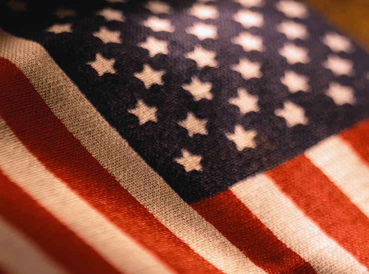 sepia-toned photo of roughly woven U.S. flag