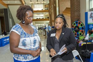 Nneka Norman-Gordon, right, the state's Higher Education Resource Officer, chats with Cynthia Stone, left, director of MTSU's Student Union, during an Aug. 6 visit to campus. (MTSU photo by J. Intintoli)