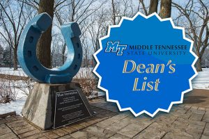 The MTSU Blue Horseshoe is shown in Walnut Grove on a snow-blanketed campus, overlaid by the MTSU Dean's List badge. (MTSU file photo by Andy Heidt)