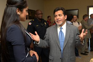 "Former U.S. Attorney General Alberto Gonzales talks with an MTSU student after his ""Law School and the Legal Profession"" talk at the university's Paul W. Martin Sr. Honors Building Wednesday, Sept. 25. (MTSU photo by J. Intintoli)"