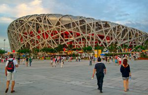 "Tourists and citizens walk through the plaza surrounding China's Beijing National Stadium, known as ""the Bird's Nest,"" during the 2008 Olympics in this photo by MTSU President Sidney A. McPhee."