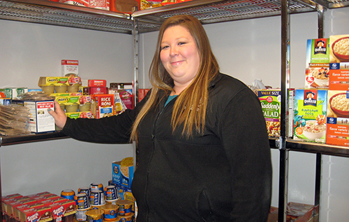 Becca Seul, who oversees the MTSU Student Food Pantry, says she hopes the upcoming C-USA food drive will help stock the pantry shelves in the Student Services and Admissions Center. (Photo by MTSU News and Media Relations)