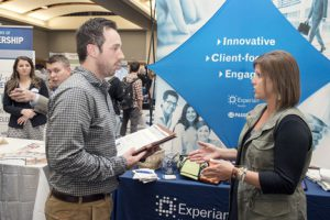 Taylor Shuff, an MTSU graduate student, chats with Brandi Thornhill from Experian during the 2014 Fall Career Fair held Thursday, Oct. 23, in the MTSU Student Union Ballroom. (MTSU photo by Andy Heidt)
