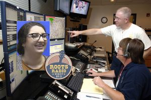 MTSU sociology graduate student & Murfreesboro Police dispatcher Katherine Rowe is shown at left with the WMOT-FM Roots Radio 89.5 logo, superimposed over a file photo of John Adkerson, 911 dispatcher, seated, and fire station chief Bradley Vance, explaining the 911 system at the Tinker Air Force Base emergency communications center near Oklahoma City, Oklahoma. (Photo courtesy of Tinker AFB/Dave Faytinger)