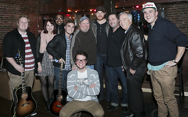 MTSU songwriters pose for a group photo after the Dec. 7 inaugural benefit concert for the Department of Recording Industry's commercial songwriting concentration at Nashville's Listening Room Cafe. Standing from left are MTSU students Kyle Crownover, Caitlin Spencer, Terrez Sieber and Collin Baxter; program coordinator Odie Blackmon; MTSU alumnus Eric Paslay and his fellow and Grammy-nominated songwriter Dylan Altman; mass communication dean Ken Paulson; and MTSU student Nick Carpenter. MTSU student Zack Russell is kneeling in front. (Photo submitted)