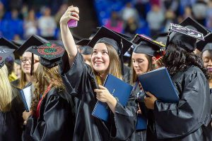 Cannon County native Hannah Nokes snaps a selfie with her new Bachelor of Science in education degree from MTSU at Saturday's fall 2014 commencement in Murphy Center. (MTSU photo by News and Media Relations)