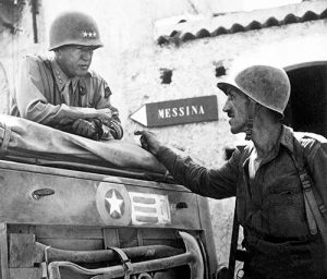 Lt. Col. Lyle Bernard, right, commanding officer of the U.S. Army's 30th Infantry Regiment and a prominent figure in the second daring amphibious landing behind enemy lines on Sicily's north coast, discusses military strategy with Lt. Gen. George S. Patton near Brolo, Sicily, in 1943. MTSU professor Derek Frisby is leading a new World War II-focused study-abroad excursion to Italy and Sicily this summer. (Photo courtesy of the National Archives and Records Administration/Army Signal Corps)