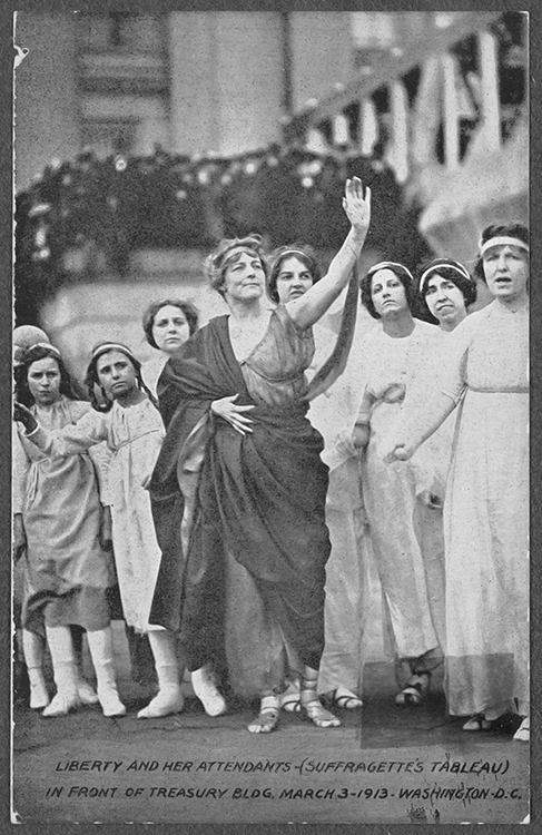 "Choreographer and suffragist Florence Fleming Noyes, center, poses as ""Liberty"" with fellow activists as her attendants in a ""Suffragette's Tableau"" in front of the U.S. Treasury Building in Washington, D.C., on March 3, 1913, the day before President Woodrow Wilson's first inauguration, to bring attention to women's right to vote. The 19th Amendment was passed seven years later. (file photo by L & M Ottenheimer, Baltimore, Md./Library of Congress)"