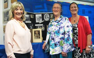 """In this 2015 file photo, sisters Angie Kleineau of Murfreesboro, left, Benita Lane of Carthage, Tennessee, and Ginger Lowery of Murfreesboro pose with an extensive display commemorating the life of their great-aunt, renowned Tenneesse educator Mary Ealla """"Miss Mary"""" Hall, in her former classroom at the Campus School open house April 14. Not pictured is their brother, Ben Hall McFarlin Jr. of Murfreesboro."""