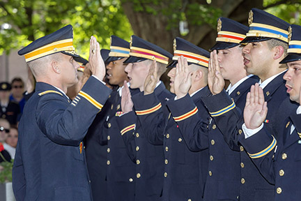 MTSU military science chair Joel Miller, left, administers the U.S. Army oath to part of the 13 senior cadets who became U.S. Army second lieutenants. The spring commissioning ceremony took place Friday, May 8, outside the Tom H. Jackson Building. (MTSU photos by J. Intintoli)
