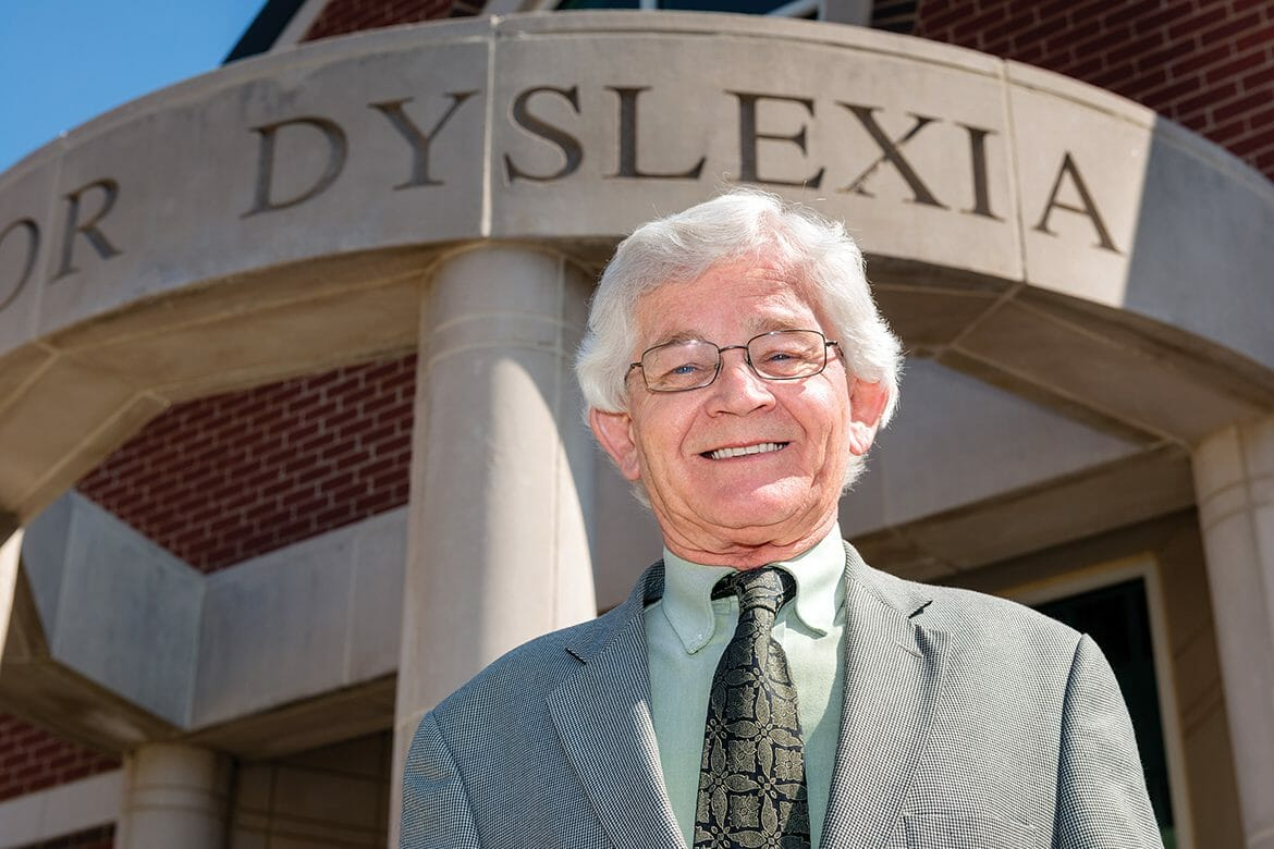 "Dr. James ""Jim"" Herman, director of MTSU's Center for the Study and Treatment of Dyslexia, pauses outside the center's entrance on North Baird Lane. (MTSU photo by Darby Campbell)"