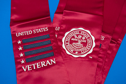 Made by Jostens, the red stole, with both veteran and MTSU logos, is awarded to graduating student-veterans.