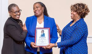 Dr. Linda M. Clark, center, smiles after receiving the 2016 John Pleas Award from Drs. Gloria Bonner, left, assistant to the president, and Michaele Chappell, a professor of mathematical sciences and the 2015 Pleas Award recipient, at a Feb. 26 ceremony in MTSU's Tom H. Jackson Building. (MTSU Photo by J. Intintoli)