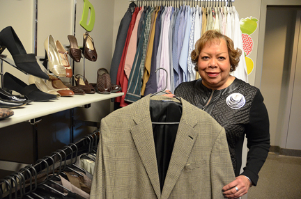 June Adams, new transfer adviser in the MTSU College of Education, holds one of the men's sports coats available at Clothing Our Educators, a small boutique she opened on the second floor of the College of Education Building that provides free professional clothing to teaching students getting ready to enter the classroom. (MTSU photo by Jimmy Hart)