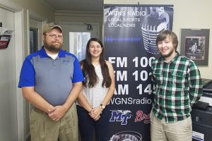 """Dr. Patrick Richey, left, director of forensics at MTSU and coach of the Blue Raider Debate Team, is shown at WGNS studios with debate team members Skye Irish and Alex Fingeroot before their appearance on the """"Action Line"""" program. (MTSU photo by Jimmy Hart)"""