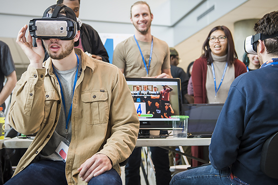 "Attendees try out the first-place winner ""VR-Maze.com,"" a virtual reality maze game for up to 100 players per map, during the Feb. 5 MTSU computer science Hack MT in the Science Building's Liz and Creighton Rhea Atrium. (MTSU photo by Kimi Conro)"