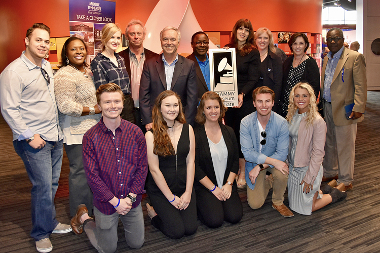 Students, faculty and friends of MTSU's College of Media and Entertainment surround President Sidney A. McPhee, who accepted a plaque that designates the university as the 10th member of the Grammy Museum's Educational Affiliate program. (MTSU photo by Andrew Oppmann)