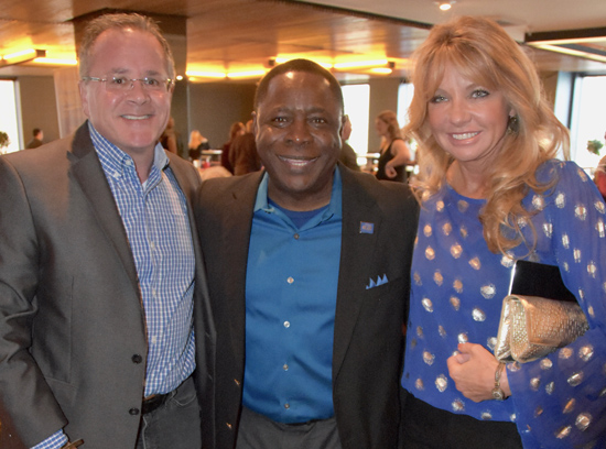 MTSU President Sidney A. McPhee, center, poses with Grammy nominee, MTSU alumnus and Academy of Country Music CEO Pete Fisher, left, and Fisher's spouse, Hope, at a reception in Los Angeles honoring the university's Grammy nominees. (MTSU Photo by Andrew Oppmann)