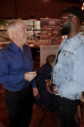 Ken Paulson, left, dean of MTSU's College of Media and Entertainment, chats with GRAMMY-winning artist and MTSU alumnus Torrance Esmond at Friday's Southern California alumni reception. (MTSU photo by Andrew Oppmann)