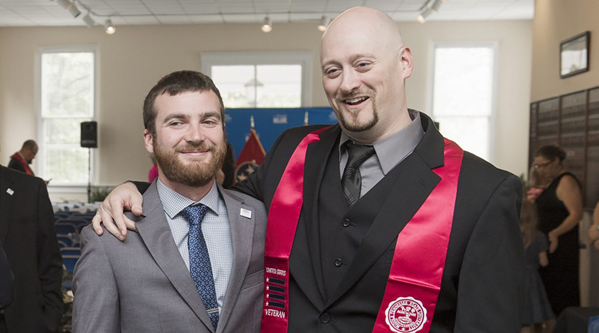 MTSU student veteran Stephen White, right, and Sean Martin, transition manager for the Charlie and Hazel Daniels Veterans and Military Family Center, pose for a keepsake photo April 19 in Cantrell Hall of the Tom H. Jackson Building during a Stole Ceremony recognizing veterans who are graduating from MTSU. (MTSU photo by Andy Heidt)