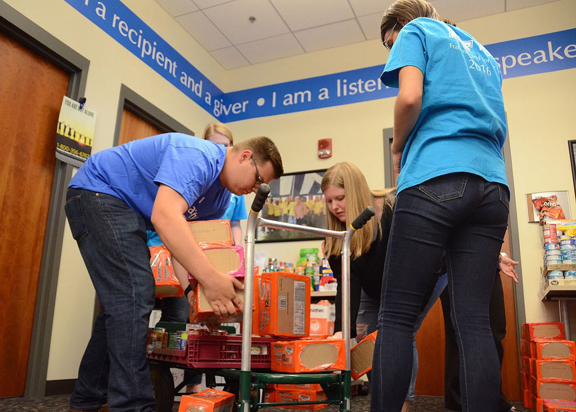 Members of MTSU's Fraternity and Sorority Life pack up donations stored inside the Student Union that were collected during a recent food drive in support of the Student Food Pantry. Pictured, from left to right, are Jake West, Greek Week committee member, Taylor Hutson, Panhellenic vice president of recruitment, and Shalayna Hoekstra, Greek Week chair. (MTSU photo by Jimmy Hart)