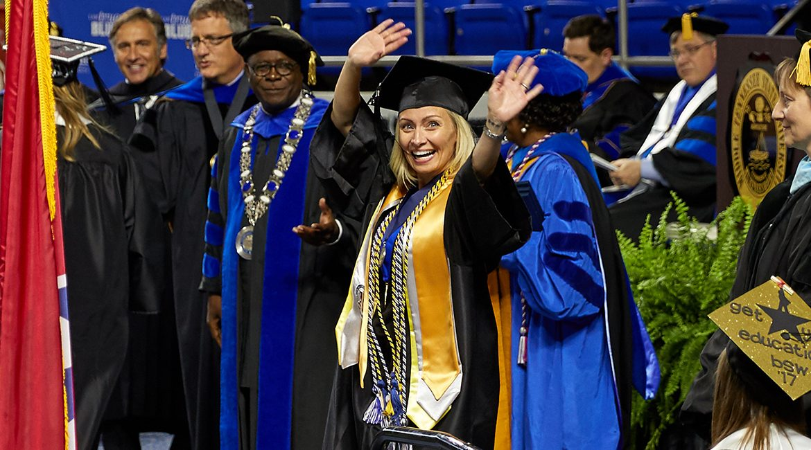 Jamie Butera celebrates as she crosses the stage at Murphy Center to accept her bachelor's degree during the May 6 undergraduate commencement ceremony. (Photo submitted)