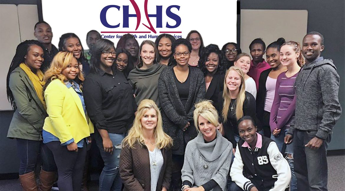 Interns who have worked on projects for MTSU's Center for Health and Human Services pose with interim center director Cynthia Chafin, who is shown kneeling at left on the front row. Their internships help promote healthy lifestyles and enrich their educational experiences. (Photo submitted)