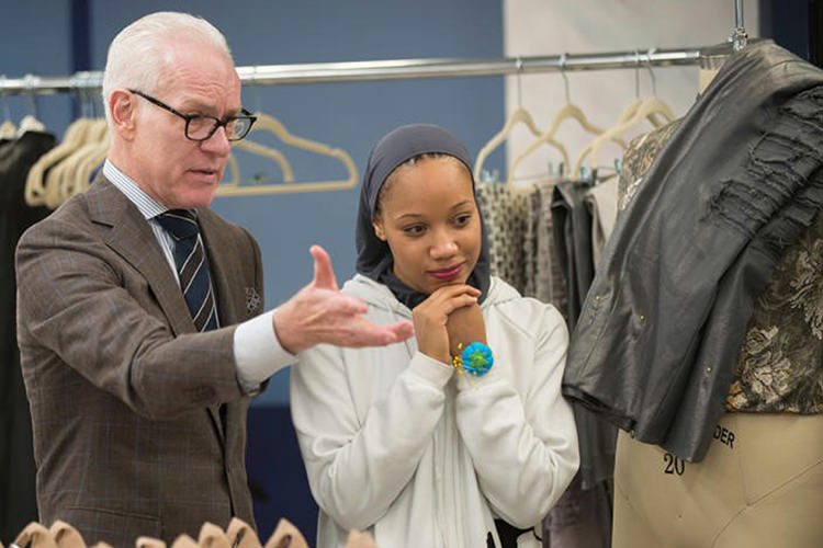 """Project Runway"" host Tim Gunn discusses fashion with MTSU alumna Ayana Ife, a contestant on Season 16 of the reality television program, in this 2017 photo. Ife, who earned plenty of acclaim for her designs, finished as the runner-up. (Photo courtesy of Barbara Nitke/Lifetime)"