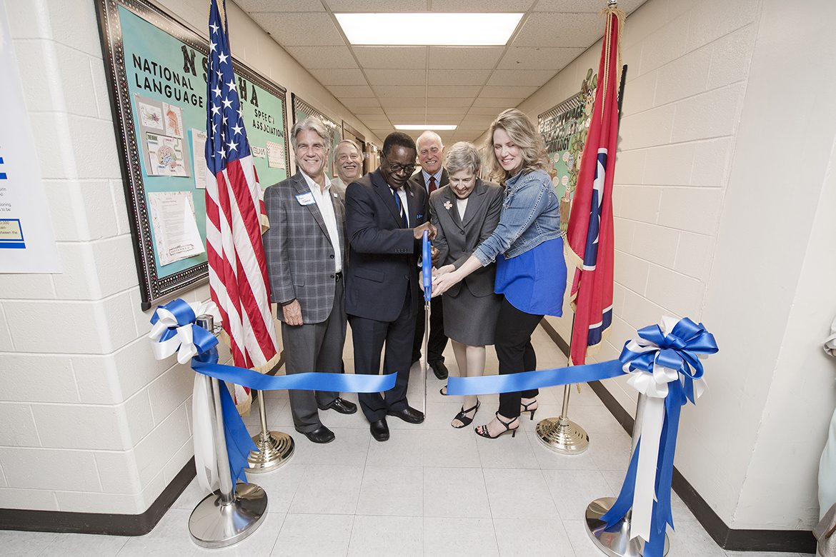 Officials are all smiles during the ribbon-cutting ceremony Friday, Oct. 6, for the new location of the the Speech-Language-Hearing Clinic inside Alumni Memorial Gym at MTSU. Pictured, from left, are: Bill Jones, Christy Houston Foundation Board chairman; Terry Whiteside, dean, College of Behavioral and Health Sciences; MTSU President Sidney A. McPhee; Doug Winborn, chair of the Department of Health and Human Performance; Rebecca Fischer, Speech-Language Pathology and Audiology faculty; and Elizabeth Smith, clinic coordinator. (MTSU photo by Andy Heidt)