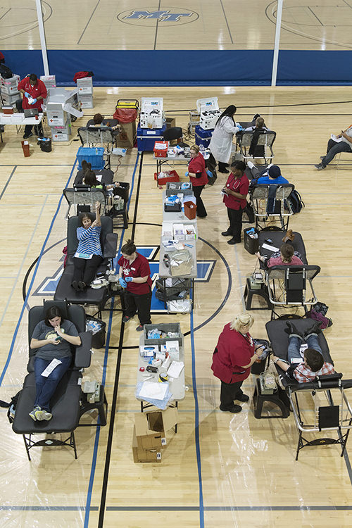 "A full house of donors give lifesaving blood on the first day of MTSU's 2017 ""Bleed Blue, Beat WKU"" blood drive in the university's Recreation Center. The 2018 ""Bleed Blue"" MTSU community blood drive is set 10 a.m.-6 p.m. Monday-Wednesday, Oct. 29-31, and donors can make appointments now at http://ow.ly/qU6X30miRZ2. (MTSU file photo by Andy Heidt)"