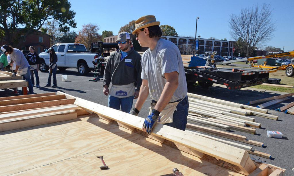 "MTSU students and volunteers work during a November 2017 ""panel build"" on the parking lot of the Campus Recreation Center, creating walls that will eventually result in a Habitat for Humanity house for a local family. The fall 2019 Habitat Build project is set Wednesday, Nov. 27, from 8 a.m. to 4 p.m. at 523 E. Castle St. (MTSU file photo by Jayla Jackson)"