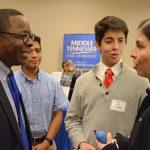MTSU President Sidney A. McPhee visits with Cesar Sr., Cesar Jr. and Maria Juarez of Birmingham.