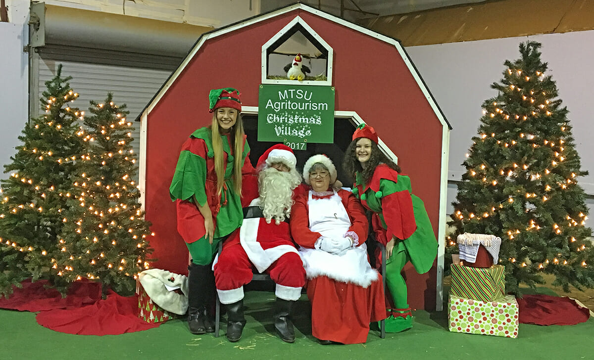 Santa, Mrs. Claus and elves