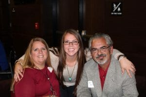 Kristin Uselton with her parents.