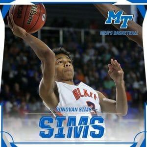 Donovan Sims playing basketball.
