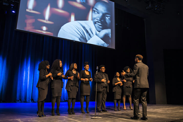 "The MTSU Generation of Purpose gospel choir performs ""King Jesus is A-Listening"" during the Monday, Jan. 15, celebration and candlelight vigil at Tucker Theatre in honor of Dr. Martin Luther King Jr. (MTSU photo by Eric Sutton)"