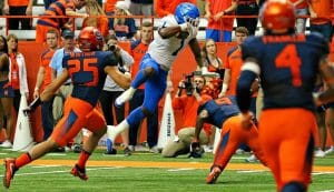 Shane Tucker hurdles Syracuse football player.