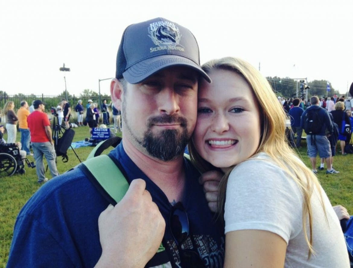 Kaylyn Slatter posing with her dad.