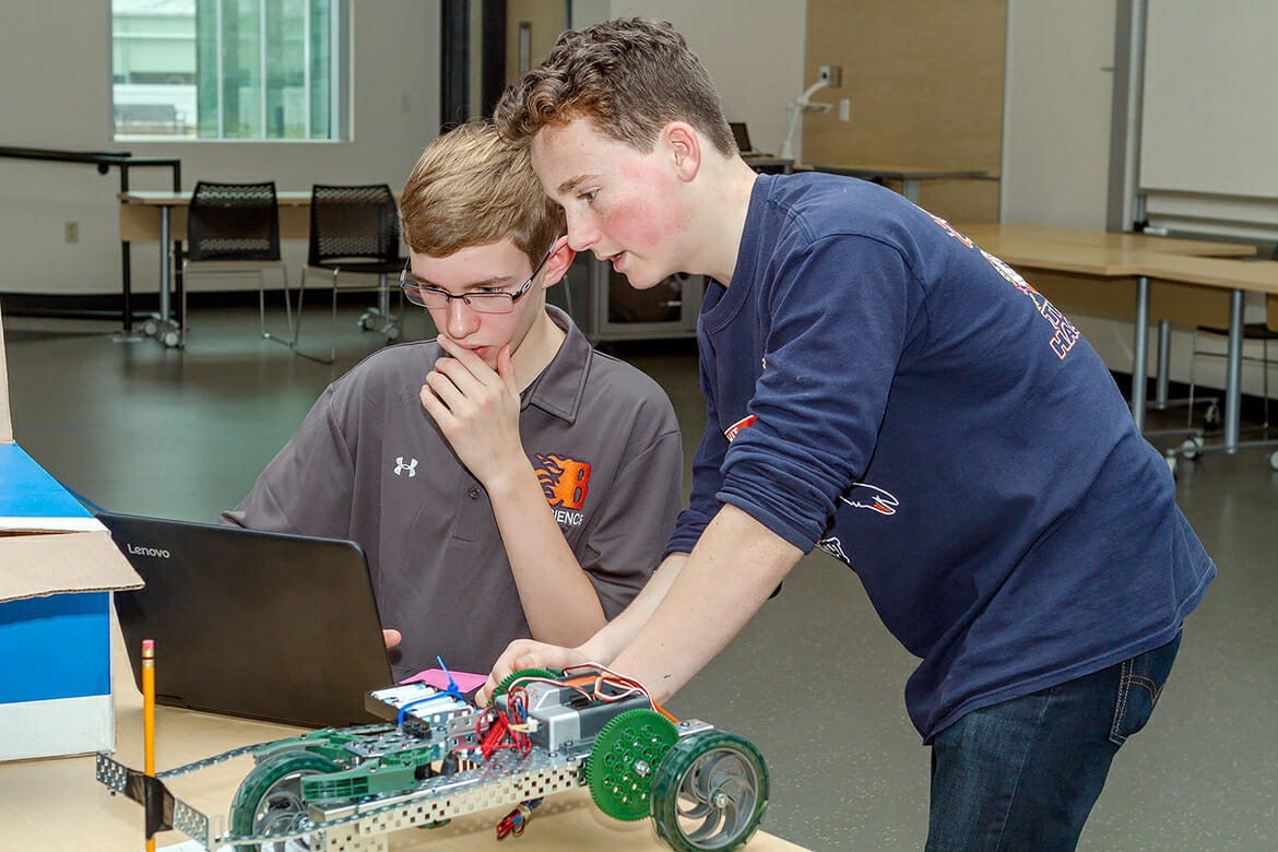 "Blackman High School students Ian Goodman and Micah Wolfgram work on a ""battery buggy"" project at the 23rd Regional Science Olympiad held Feb. 24 at MTSU. A total of 28 high school and middle school teams received a hands-on experience into the world of science. (MTSU photo by J. Intintoli)"