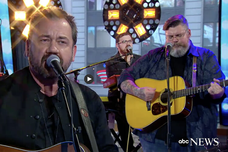 "MTSU School of Music alumnus Micah Snow, center, plays keyboards and sings with bandleader Dan Tyminski, left, as multi-instrumentalist Tony Wray, right, plays guitar during the Tyminski Band's January appearance on ABC's ""Good Morning America."" (Photo courtesy of ABC News)"