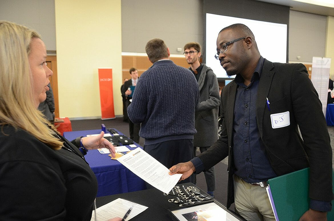 "MTSU M.B.A. student Ayodeji ""D.J."" Makinde, right, speaks to a representative from Hankook Tire America Corp. during the Business Exchange for Student Talent, or BEST, Career Fair held Wednesday, March 21, in the MTSU Student Union Building. (MTSU photo by Jayla Jackson)"